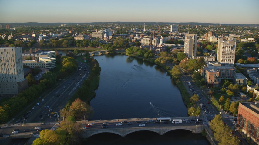 6k aerial video flying over Charles River, approach Harvard University, Massachusetts, sunset Aerial Stock Footage | AX146_018