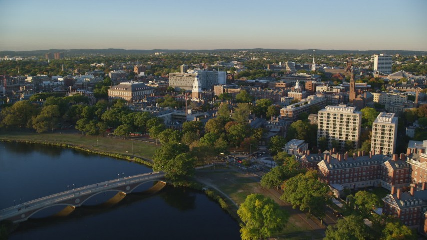 6k stock footage aerial video flying over Chalres River, approach Harvard University, Massachusetts, sunset Aerial Stock Footage | AX146_019