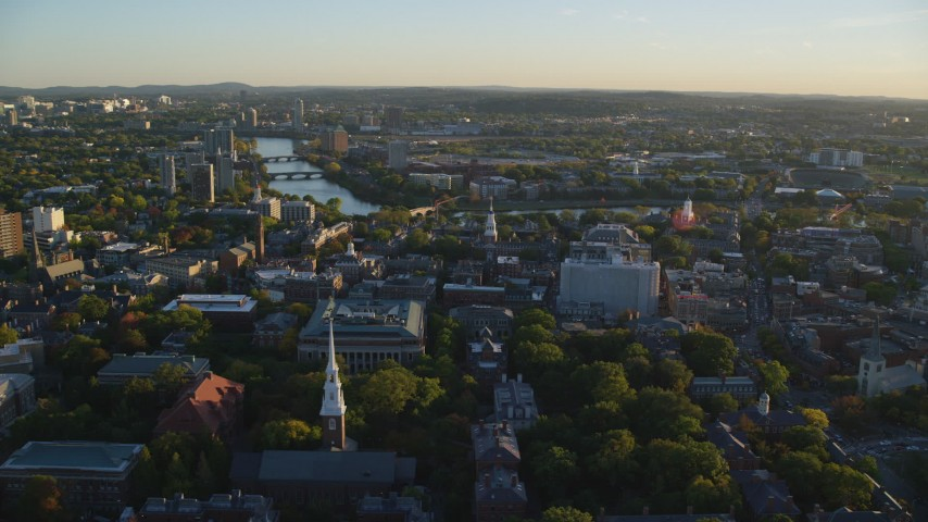 6k stock footage aerial video flying by Harvard University, Cambridge, Massachusetts, sunset Aerial Stock Footage | AX146_023