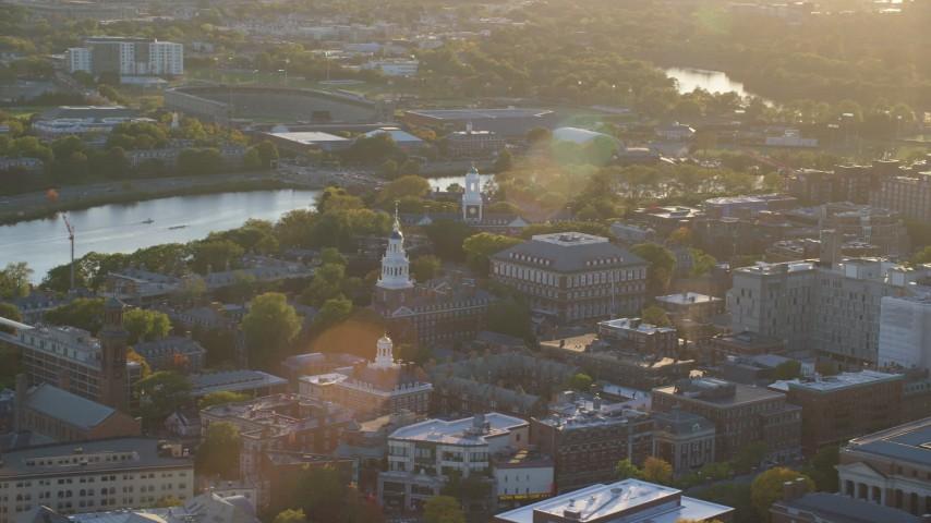 6k stock footage aerial video orbiting Harvard University buildings, Cambridge,  Massachusetts, sunset Aerial Stock Footage | AX146_025