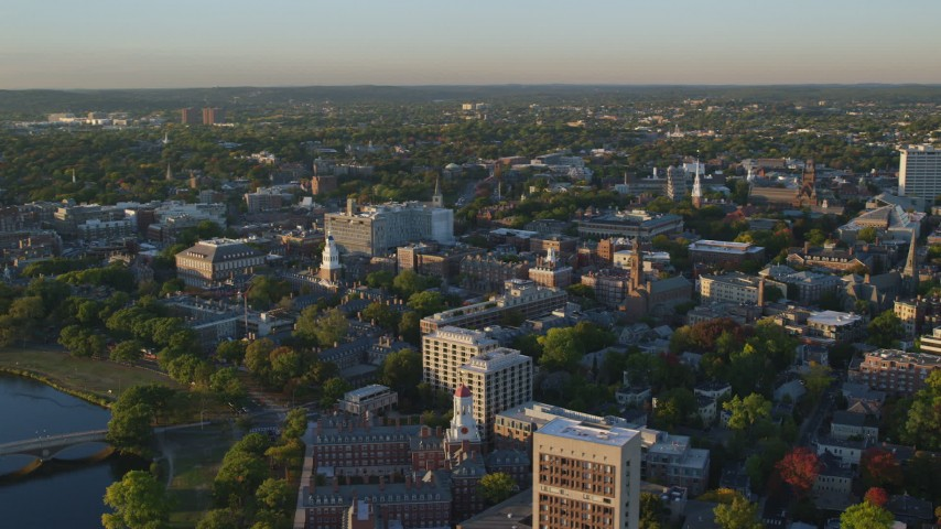 6k aerial video orbiting Harvard University,  Cambridge, Massachusetts, sunset Aerial Stock Footage | AX146_028