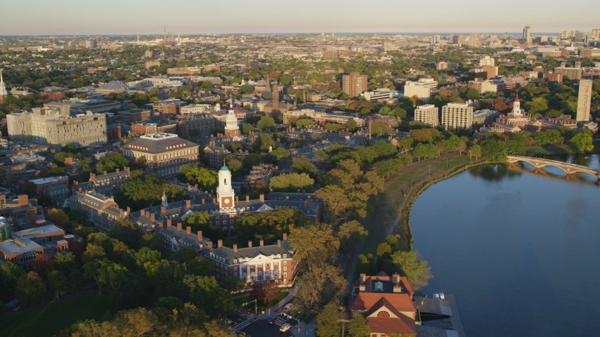 6k stock footage aerial video flying by Harvard University, Cambridge, Massachusetts, sunset Aerial Stock Footage | AX146_031