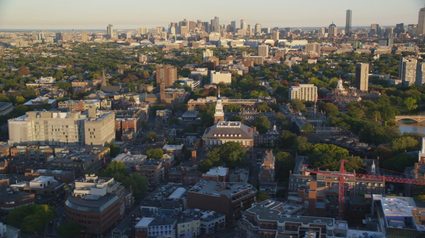 6k stock footage aerial video of Harvard University, downtown skyline, Downtown Boston, Massachusetts, sunset Aerial Stock Footage | AX146_032