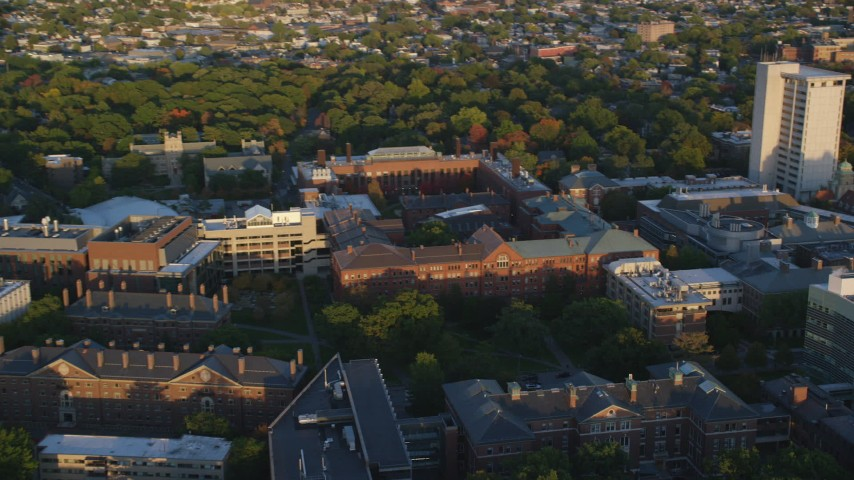 6k stock footage aerial video approaching Harvard University buildings, Cambridge, Massachusetts, sunset Aerial Stock Footage | AX146_034