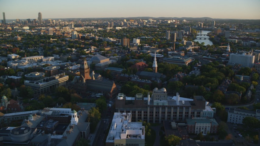 6k stock footage aerial video flying by Harvard University, Cambridge, Massachusetts, sunset Aerial Stock Footage | AX146_035