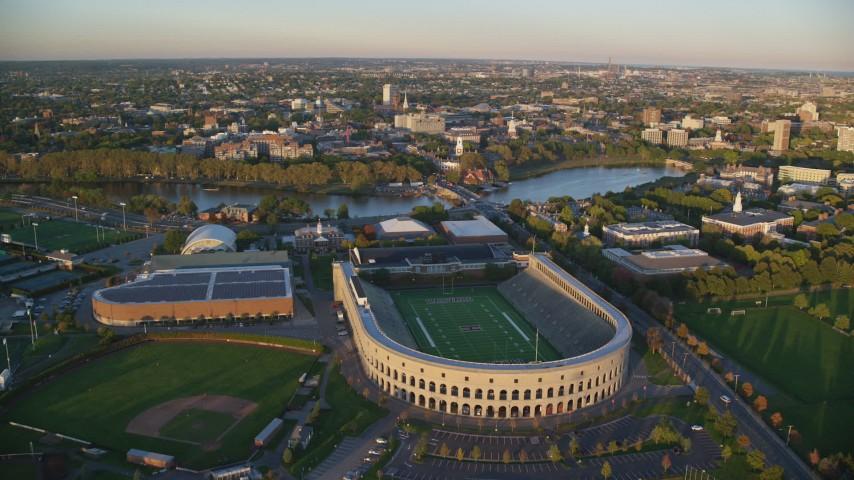 6k aerial video approaching Harvard Stadium, Harvard University, Massachusetts, sunset Aerial Stock Footage | AX146_041