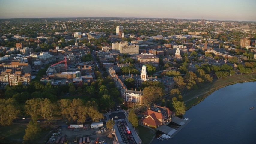 6k aerial video approaching Eliot House from Charles River, Harvard University, Massachusetts, sunset Aerial Stock Footage | AX146_043