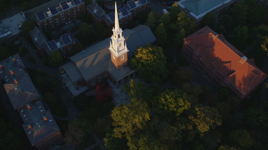 6k stock footage aerial video tilting to a bird's eye view, Memorial Church, Harvard University, Massachusetts, sunset Aerial Stock Footage | AX146_045