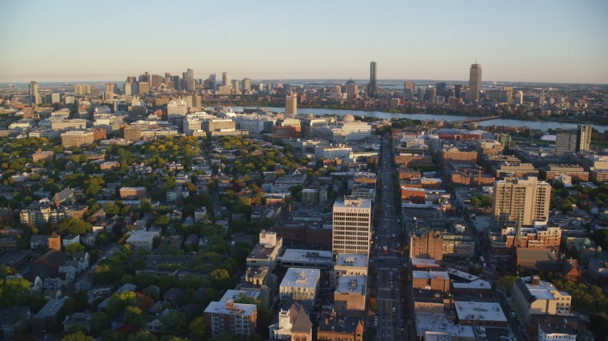 6k stock footage aerial video flying by office buildings, Downtown Boston skyline, Cambridge, Massachusetts, sunset  Aerial Stock Footage | AX146_047