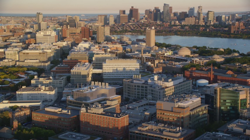 6k stock footage aerial video flying by Massachusetts Institute of Technology, Cambridge, Massachusetts, sunset Aerial Stock Footage | AX146_048