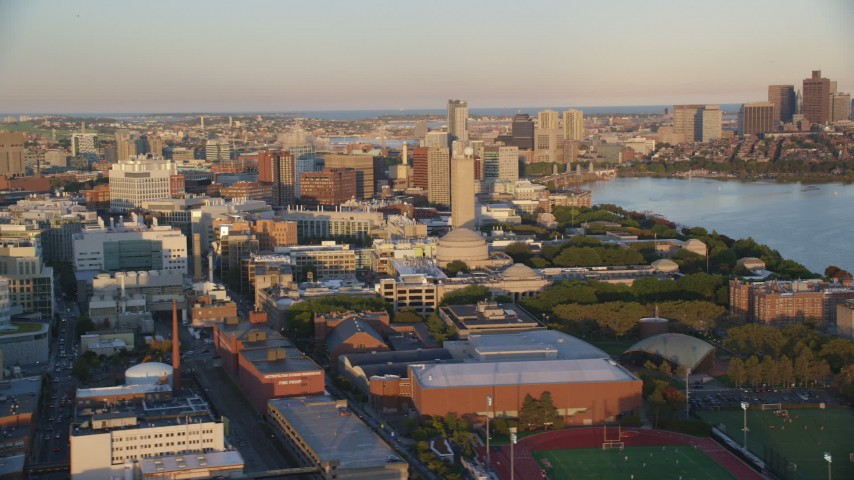 6k stock footage aerial video flying by Massachusetts Institute of Technology, Cambridge, Massachusetts, sunset Aerial Stock Footage | AX146_049