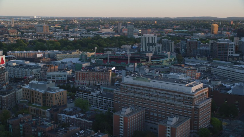 6k stock footage aerial video approaching Fenway Park, Massachusetts, sunset Aerial Stock Footage | AX146_050