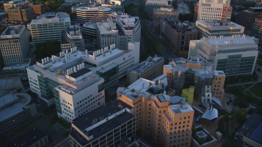 6k stock footage aerial video flying over buildings, Massachusetts Institute of Technology, Massachusetts, sunset Aerial Stock Footage | AX146_054