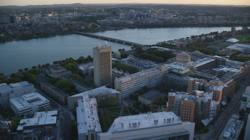 6k stock footage aerial video panning right by Massachusetts Institute of Technology, Massachusetts, sunset Aerial Stock Footage | AX146_055