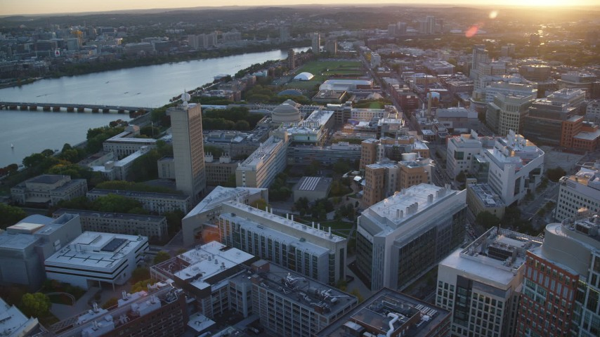 6k stock footage aerial video flying by Massachusetts Institute of Technology, Massachusetts, sunset Aerial Stock Footage | AX146_056