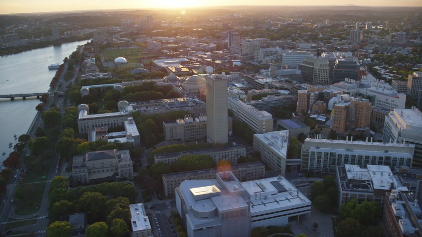 6k stock footage aerial video flying by the Massachusetts Institute of Technology, Massachusetts, sunset Aerial Stock Footage | AX146_057