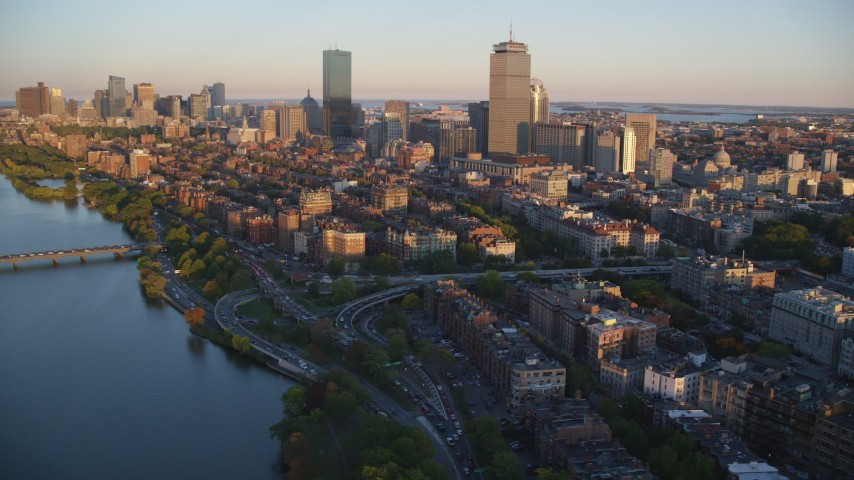 6k stock footage aerial video flying by Back Bay and skyscrapers, Downtown Boston, Massachusetts, sunset Aerial Stock Footage | AX146_060