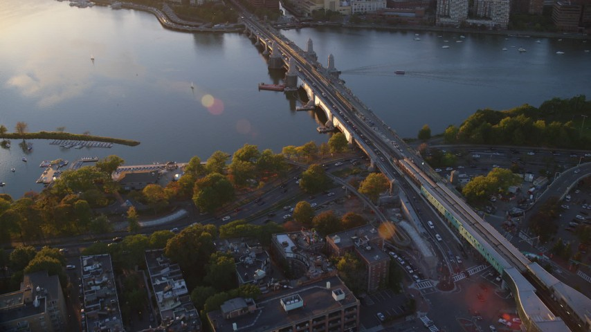 6k stock footage aerial video flying by the Longfellow Bridge, Charles River, Boston, Massachusetts, sunset Aerial Stock Footage | AX146_066