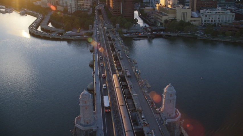 6k stock footage aerial video tracking commuter train across the Longfellow Bridge, Boston, Massachusetts, sunset  Aerial Stock Footage | AX146_069