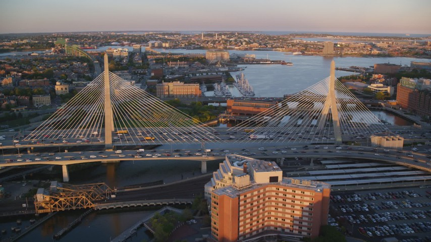 6k stock footage aerial video flying over Zakim Bridge, reveal Constitution Marina, Boston, Massachusetts, sunset Aerial Stock Footage | AX146_072