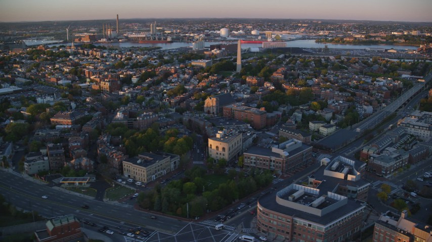 6k stock footage aerial video flying by row house, Bunker Hill Monument, Charlestown, Massachusetts, sunset Aerial Stock Footage | AX146_073