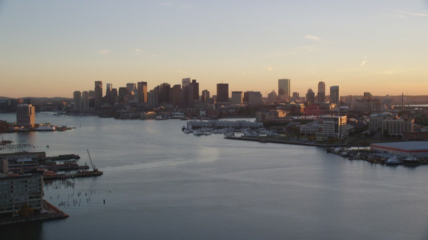 6k stock footage aerial video flying over Charles River, approach skyline, Downtown Boston, Massachusetts, sunset Aerial Stock Footage | AX146_076