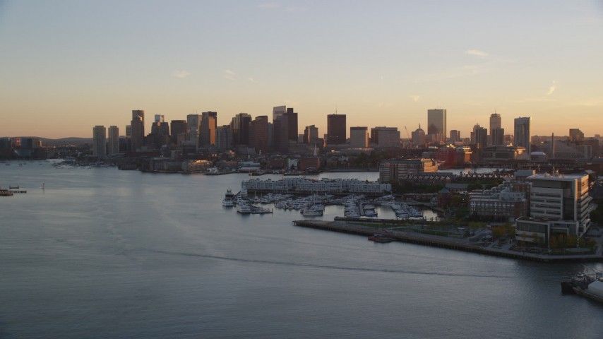 6k stock footage aerial video flying over Charles River, approaching Downtown Boston, Massachusetts, sunset Aerial Stock Footage | AX146_077