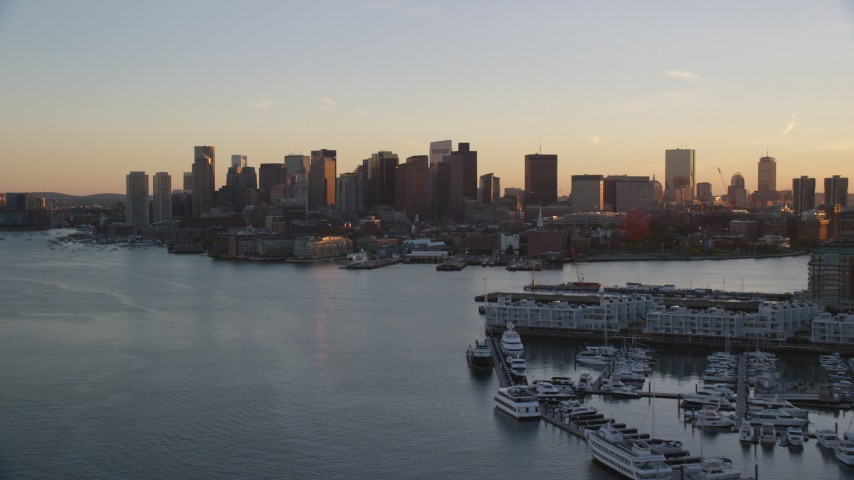 6k stock footage aerial video flying by the downtown skyline, Downtown Boston, Massachusetts, sunset Aerial Stock Footage | AX146_078
