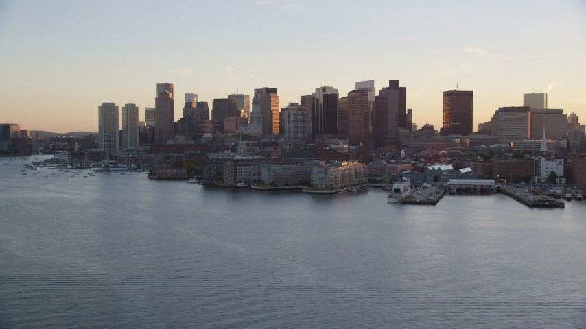 6k stock footage aerial video flying by the downtown skyline, Downtown Boston, Massachusetts, sunset Aerial Stock Footage | AX146_079
