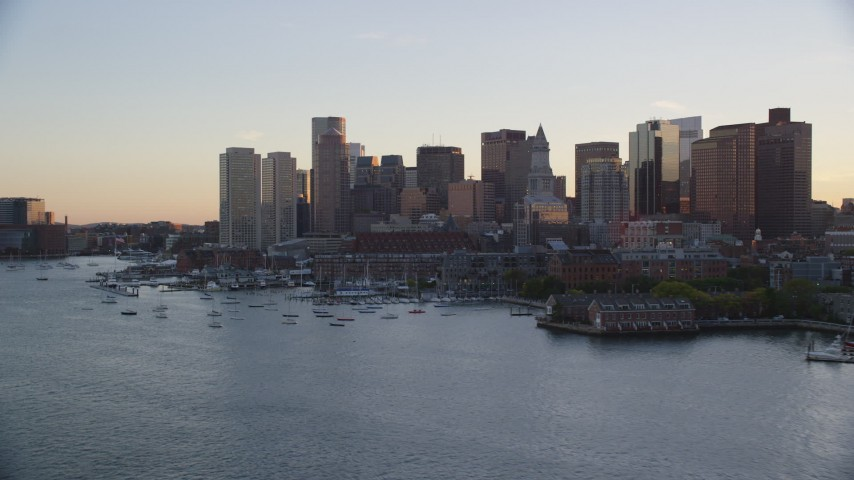 6k stock footage aerial video flying by the downtown skyline, Downtown Boston, Massachusetts, sunset Aerial Stock Footage | AX146_080