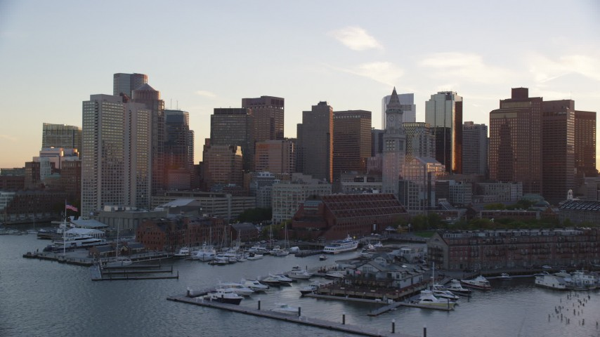 6k stock footage aerial video flying by skyscrapers, Downtown Boston, Massachusetts, sunset Aerial Stock Footage | AX146_081