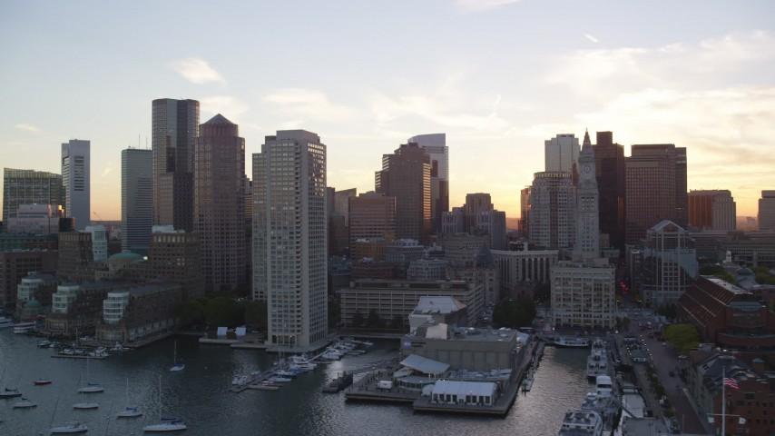6k stock footage aerial video flying by skyscrapers, Rowes Wharf, Downtown Boston, Massachusetts, sunset Aerial Stock Footage | AX146_082