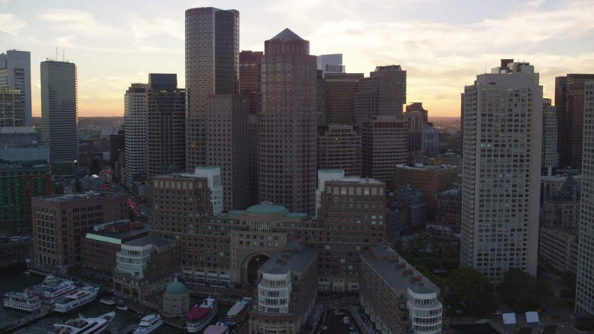 6k aerial stock footage video flying by Rowes Wharf and Downtown Boston, Massachusetts, sunset Aerial Stock Footage | AX146_083