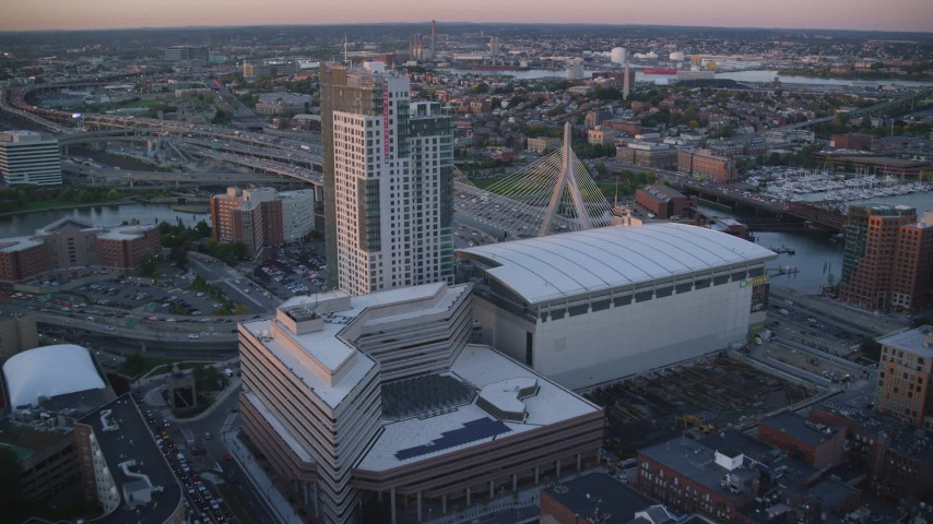 6k stock footage aerial video flying over TD Garden, approaching Zakim Bridge, Boston, Massachusetts, sunset Aerial Stock Footage | AX146_087
