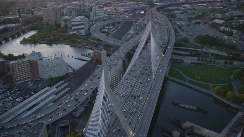 6k stock footage aerial video flying by the Zakim Bridge, Boston, Massachusetts, sunset Aerial Stock Footage | AX146_088