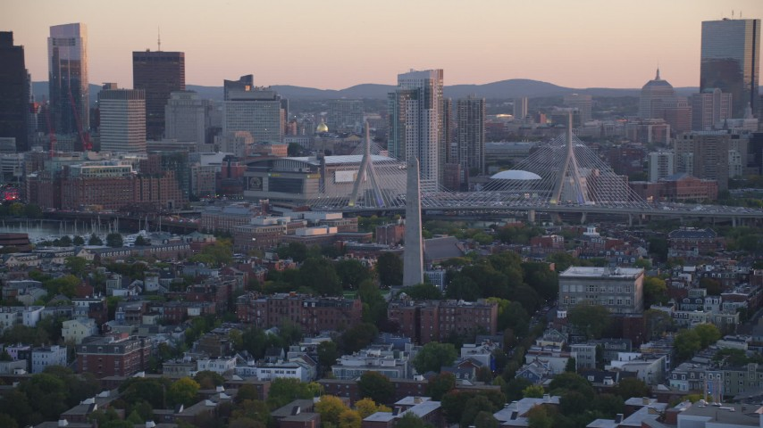 6k stock footage aerial video orbiting the Bunker Hill Monument, skyline, Charlestown, Massachusetts, sunset Aerial Stock Footage | AX146_091
