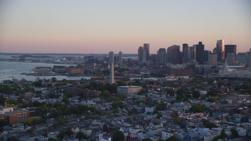 6k stock footage aerial video orbiting Bunker Hill Monument, downtown skyline, Charlestown, Massachusetts, sunset Aerial Stock Footage | AX146_094