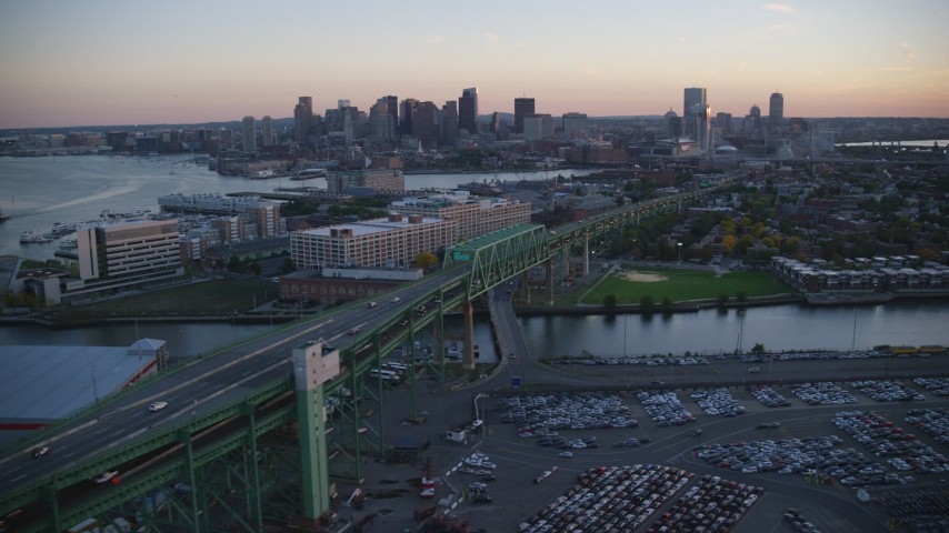 6k stock footage aerial video flying by Tobin Memorial Bridge, downtown skyline, Charlestown, Massachusetts, sunset Aerial Stock Footage | AX146_101