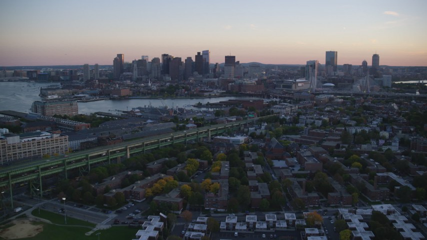 6k stock footage aerial video flying by Downtown Boston skyline, from Charlestown, Massachusetts, sunset Aerial Stock Footage | AX146_102