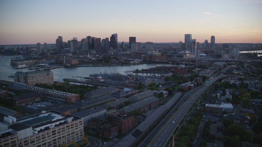 6k stock footage aerial video flying by the skyline, seen from Charleston, Downtown Boston, Massachusetts, sunset Aerial Stock Footage | AX146_103