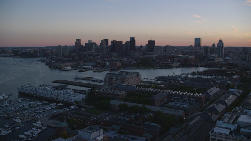 6k stock footage aerial video approaching the skyline, Downtown Boston, Massachusetts, sunset Aerial Stock Footage | AX146_108