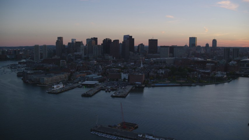 6k stock footage aerial video flying by the downtown skyline, Downtown Boston, Massachusetts, twilight Aerial Stock Footage | AX146_109