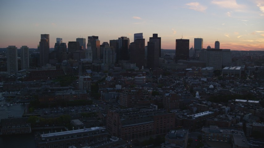 6k stock footage aerial video flying by the downtown skyline, Downtown Boston, Massachusetts, twilight Aerial Stock Footage | AX146_110