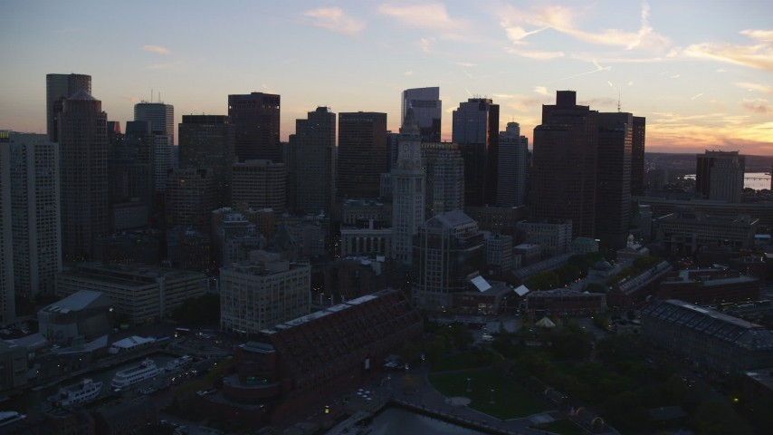 6k stock footage aerial video flying by the downtown skyline, Downtown Boston, Massachusetts, sunset Aerial Stock Footage | AX146_111