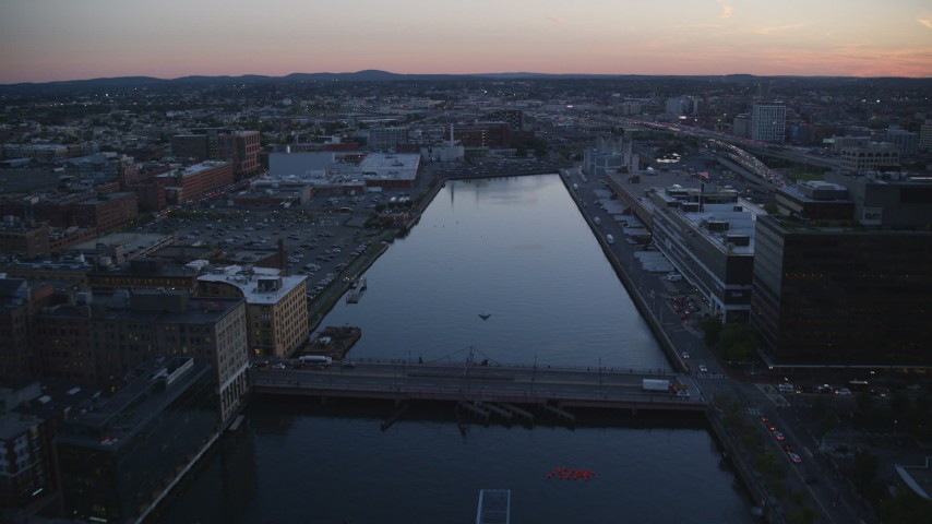 6k stock footage aerial video flying over Fort Point Channel, Downtown Boston, Massachusetts, twilight Aerial Stock Footage | AX146_112