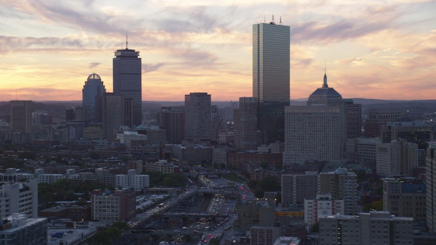 6k stock footage aerial video flying by downtown skyscrapers, Downtown Boston, Massachusetts, sunset Aerial Stock Footage | AX146_114