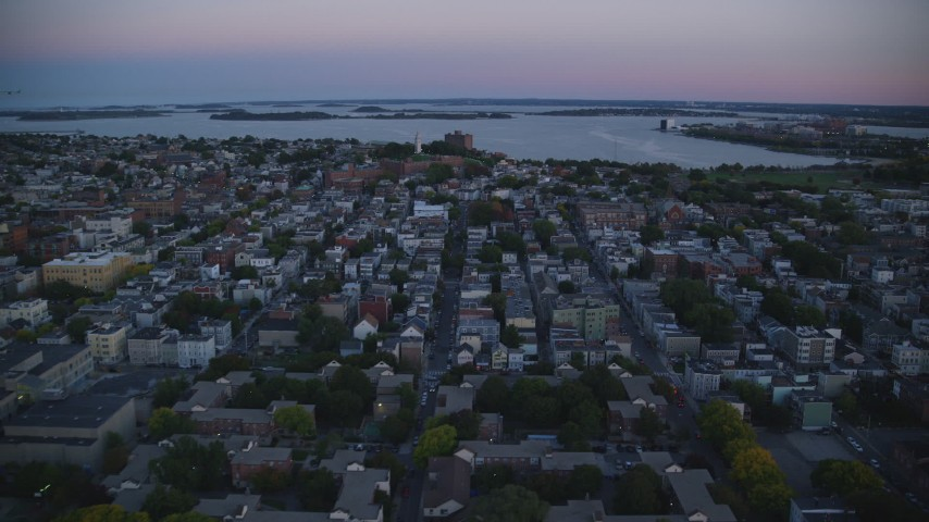 6k stock footage aerial video of Dorchester Heights Monument, row houses, South Boston, Massachusetts, twilight  Aerial Stock Footage | AX146_115