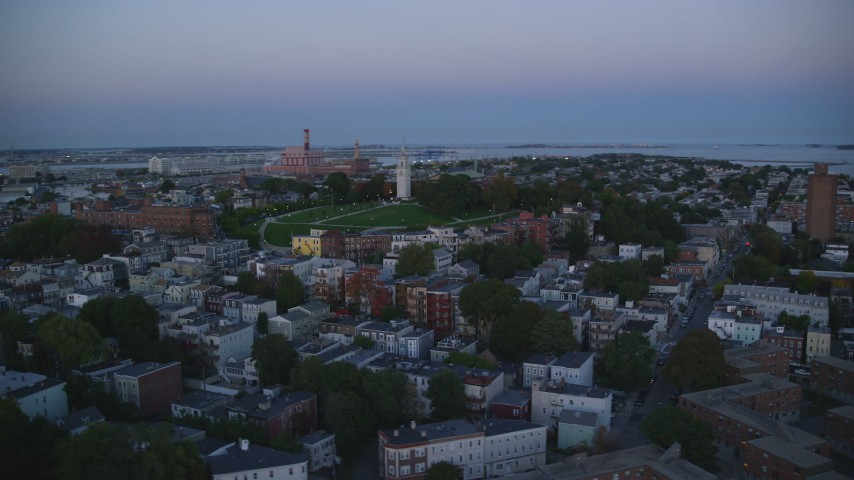 6k stock footage aerial video of Dorchester Heights Monument, row houses, South Boston, Massachusetts, twilight  Aerial Stock Footage | AX146_117