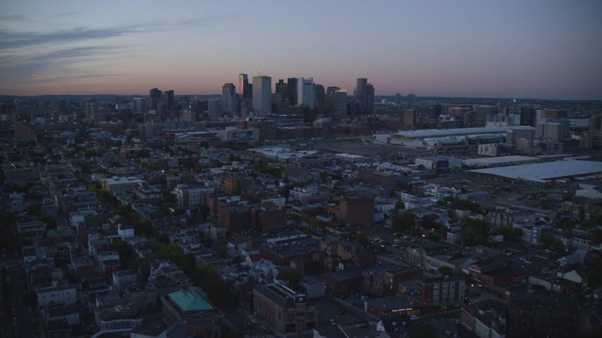 6k stock footage aerial video approaching downtown skyline, South Boston, Massachusetts, twilight Aerial Stock Footage | AX146_122