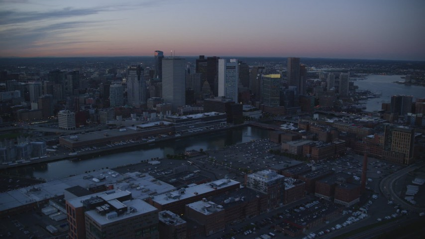 6k stock footage aerial video approaching Fort Point Channel, Downtown Boston, Massachusetts, twilight Aerial Stock Footage | AX146_124